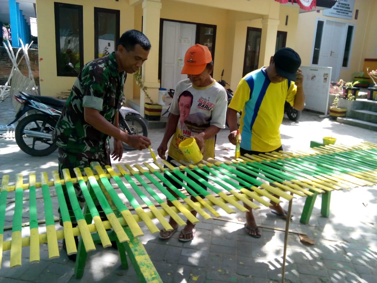 Babinsa Koramil 1401 - 03 Sendana Karya Bakti Lomba Desa