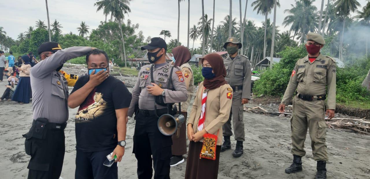 Polres Pasangkayu bersama Satpol PP Laksanakan Ops.Yustisi Di Pantai Tanjung Babia.