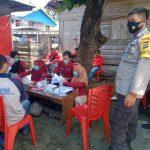 Bhabinkamtibmas Desa Tapandullu Laksanakan Pengamanan Vaksinasi